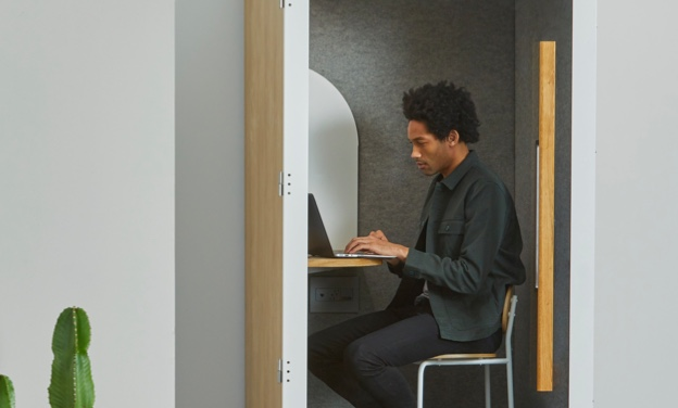Man working on computer in cubicle